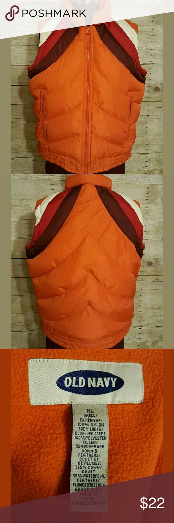Old Navy Orange Puffy Down Vest Old Navy puffy winter vest. Orange with dark purple, red, and white stripes on shoulders, sleeveless, collared, zip front, two side pockets, one inner pocket, fleece-lined, filled with down and waterfowl feathers.   Women's size XL.   Pre-owned. Excellent condition, no rips or stains. Old Navy Jackets & Coats Vests