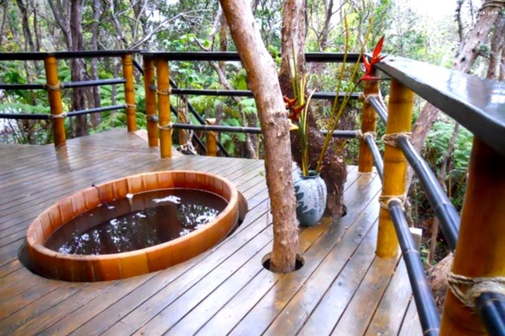 This treehouse hotel in Hawaii is located in the rain forest that extends into Hawaii Volcanoes National Park, which surrounds the Thurston Lava Tube, making it an ideal spot for glamping in Hawaii. The treehouse itself is built in trees that rise out of an ancient lava tube. You are above mid-canopy with birds flying both above and below.