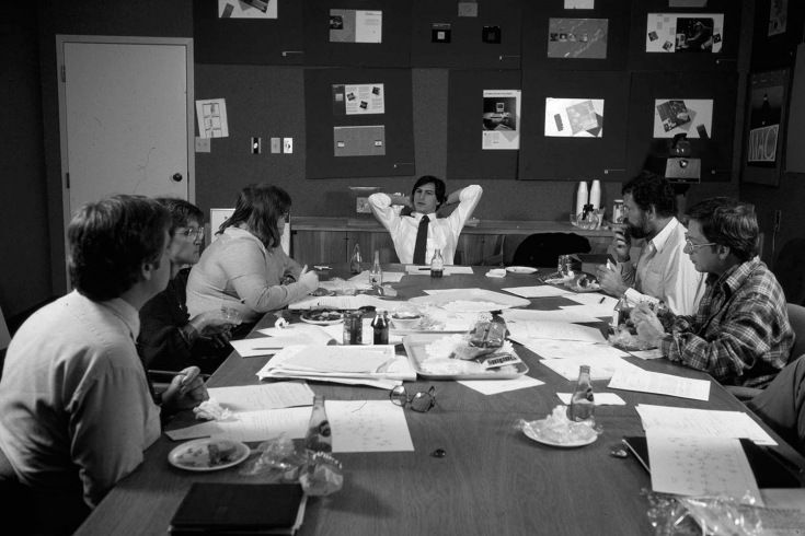 Jobs presides over a lunchtime huddle with his design team at Apple's headquarters in 1982.