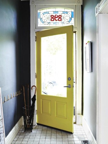 Painted Interior Door  Paint the inside of your front door a vibrant hue for a cheery entryway.   A sunny yellow door is a welcoming counterpoint to black walls and keeps the narrow hallway from feeling sombre.
