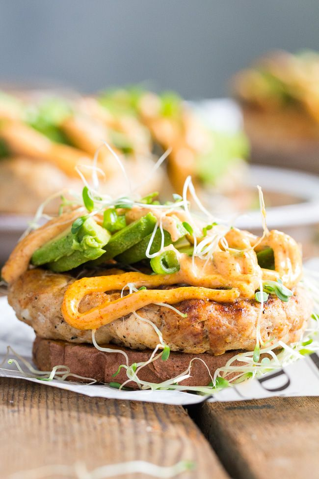 These Chipotle Ranch Chicken Burgers are loaded with your favorite flavors and perfect on a grilled sweet potato bun!  Topped with chipotle ranch sauce, avocado and sprouts for a delicious, fun, and healthy burger that might become your new favorite!  Paleo, Whole30, gluten-free, dairy-free.