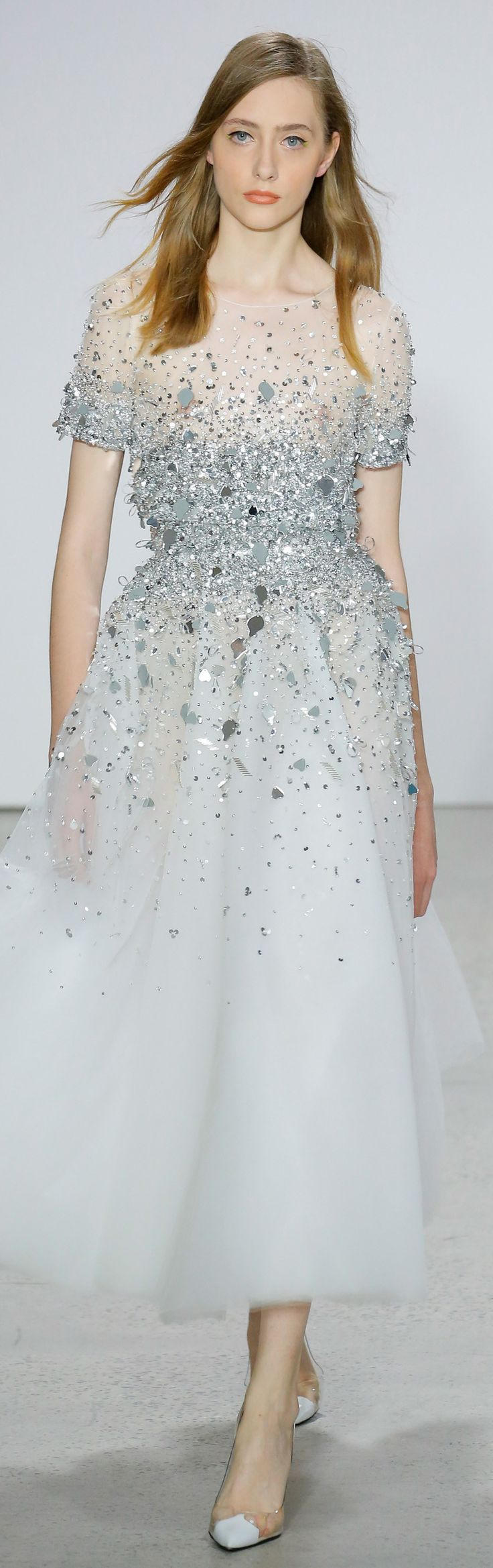 Glittering white tulle dress... floating in the air