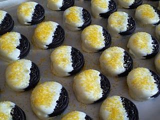 MMMM....Oreos dipped in white chocolate with some Steeler gold sprinkles.
