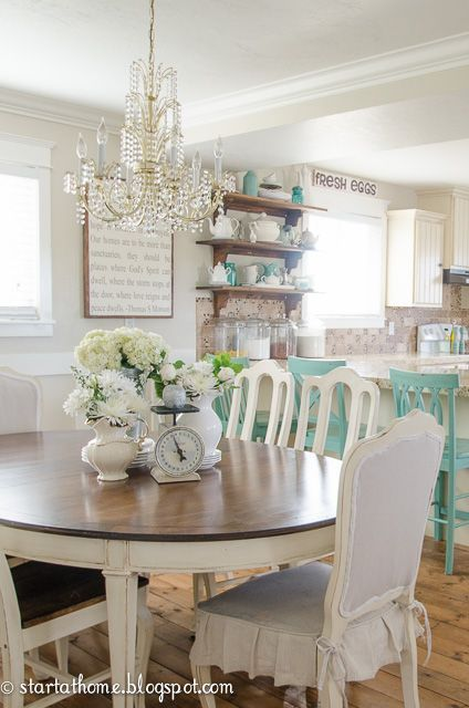 Cottage farmhouse style, decorated in shades of white cream and aqua. Dining area & kitchen.