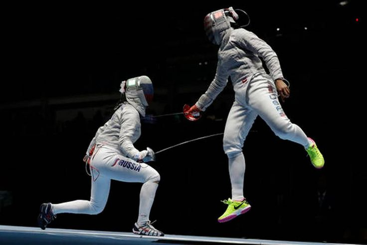 Sofya Velikaya of Russia, left, and Ibtihaj Muhammad of the United States compete in a women's team sabre fencing semifinal at the 2016 Summer Olympics in Rio de Janeiro, Brazil, Saturday, Aug. 13, 2016.