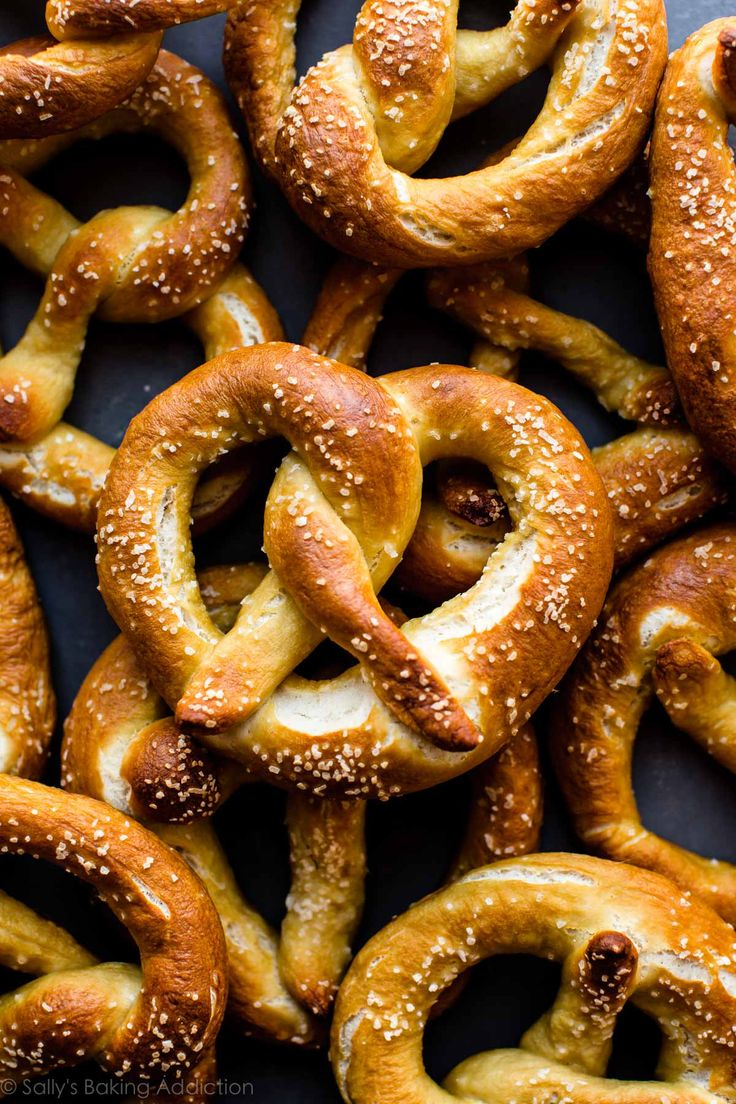How to make easy homemade soft pretzels in less than 45 minutes. Don't forget the easy spicy cheese sauce!