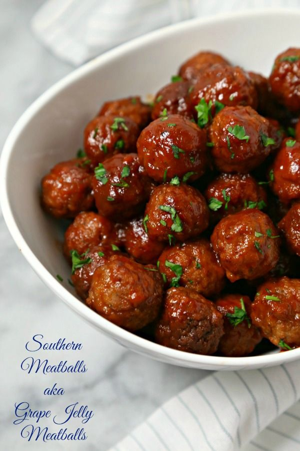 Southern Meatballs aka Grape Jelly Meatballs from CookingInStilettos.com are a retro appetizer that is packed with flavor. Just a few ingredients simmer in the slow cooker for delicious bites that your friends and family will love! Make these for your next party or tailgate!   @CookInStilettos