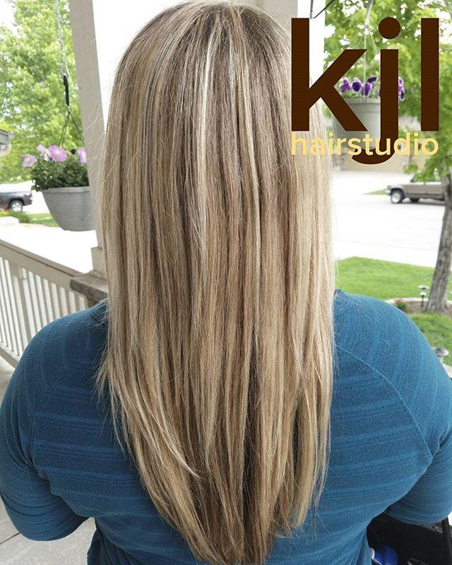 Blonde hair. Beige hair. Highlights. Long hair. Long layers. Sandy hair.