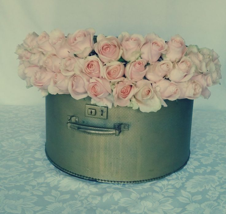 Gold hat box with pearl avalanche roses for the Elie Saab Perfume stand