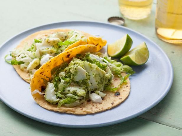 Halibut Fish Tacos with Cilantro Savoy Slaw: Start a new taco night tradition — forgo meat and cheese fillings in favor of fresh fish and vibrant salsa verde.