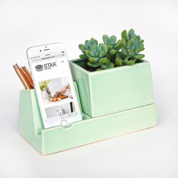 Keep your push notifications at a glance with an iPhone charging stand (that's also a planter!). | 34 Ways To Make Your Cubicle Feel Like Home