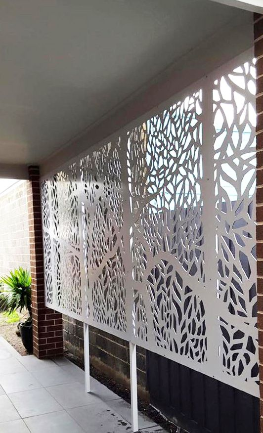 Laser cut patio screens provide privacy and shade and can be custom sized and painted in any design and material. This is QAQ's 'Forest' design. Photo by Installation Works.