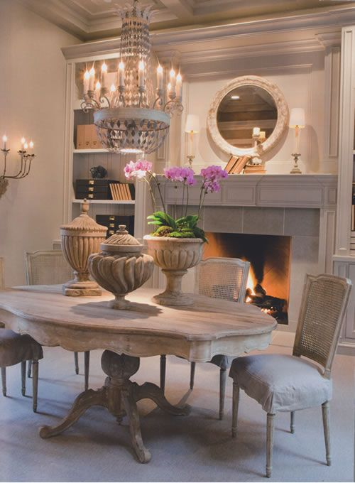 Love the table, chairs, and urns...and the chandelier. Like the scalloped edge on the table.