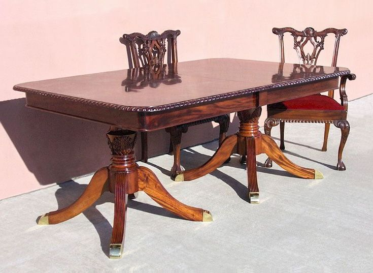 The regency dining table features two extensions that allow extending the top table from 6ft to 10ft  wide. Two pedestals assembled of turning column and four spider legs stand on the floor to support the top table.