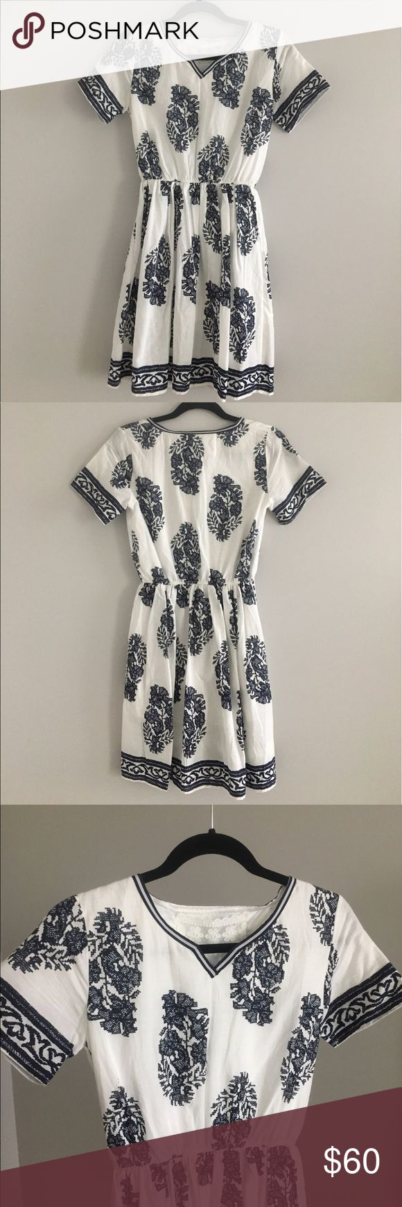 A blue and white short sleeve dress A boho short sleeve dress that can be dressed up or down! Never worn, still has the tag on it. Spool 72 Dresses