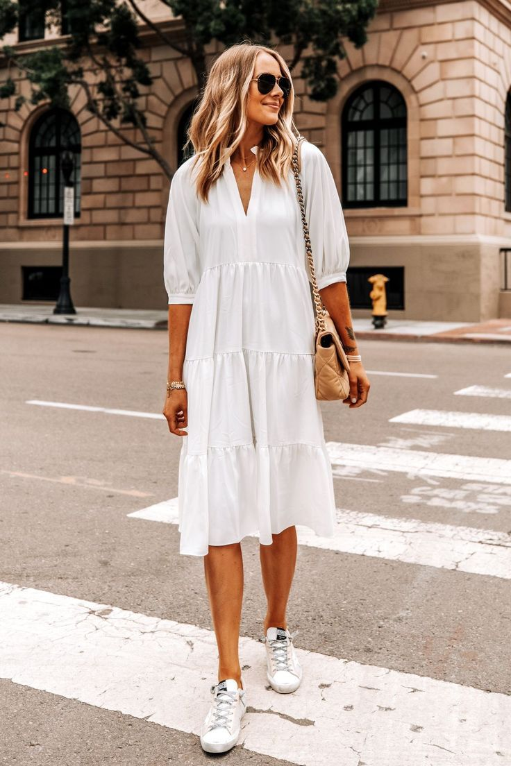 How To Pull Of Wearing A White Summer Dress With Sneakers Fashion Jackson Dress And Sneakers Outfit White Dress Summer Fashion Jackson [ 1104 x 736 Pixel ]