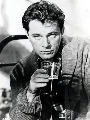 Oooh, those dreamy eyes!  Richard Burton, possibly drinking to forget Liz Taylor or her jewelry tab.  Or not!