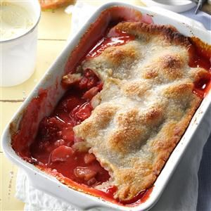 Rhubarb Strawberry Cobbler Recipe -Mom's yummy cobbler is a truly wonderful finale to any meal. This sweet-tart family favorite is chock-full of berries and rhubarb and has a thick easy-to-make crust.                                   -Susan Emery                                    Everett, Washington