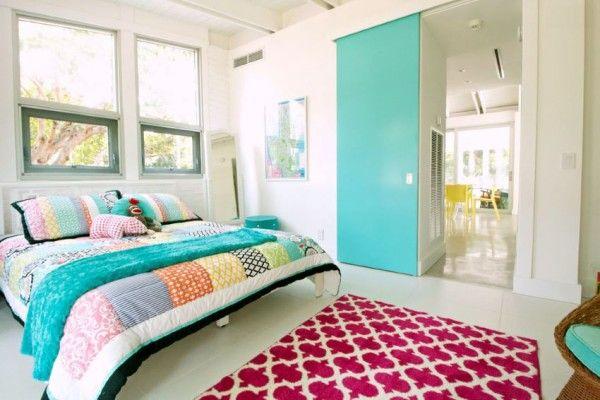Bright turquoise door in a modern eclectic bedroom
