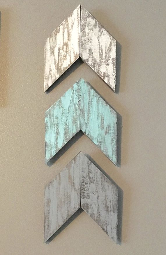 Rustic Wood Hand Painted Arrows  Set of 3 White, Robins Egg Blue, and Gray  They measure approximately 8 1/4 wide x 10 tall  My husband and I make all of our signs and decor out of our garage and home. We use cedar and age the wood with a non toxic, non chemical process. *Please note that the pictures are a close representation of our products, but they may vary slightly in color and size due to the rough nature of the wood