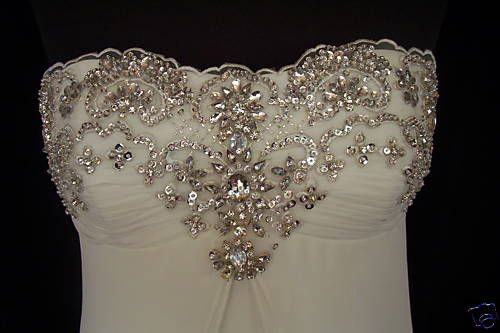 Wedding gown with beading of rhinestones - The Wedding Specialists