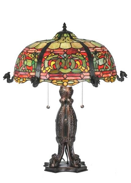 "25""""H Viking D&K Table Lamp Designed for enduring beauty, this reproduction of this Duffner & Kimberly Viking table lamp features a fascinating array of Green serpents on a Viking Red background in stained glass, to rival the original."