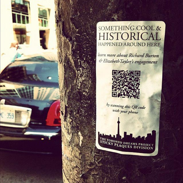 """Something Cool  HISTORICAL Happened on This Spot"" .... Toronto history enthusiast Adam Bunch has created ""sticky plaques""!  embedded with a QR code, which allows the curious to learn more about places where ""something cool [or sad] and historical happened on this spot. There are a lot of really neat stories [in Toronto]that people don't know, and if we don't know them, then you don't realize it's all around you and you risk losing it."""