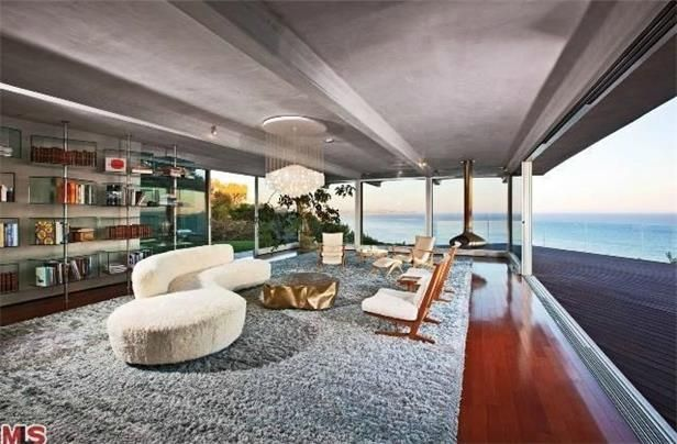 Brad Pitt  Moneyball star Brad Pitt has sold his bluff-top Malibu home to talk show host Ellen DeGeneres for $12,000,000.