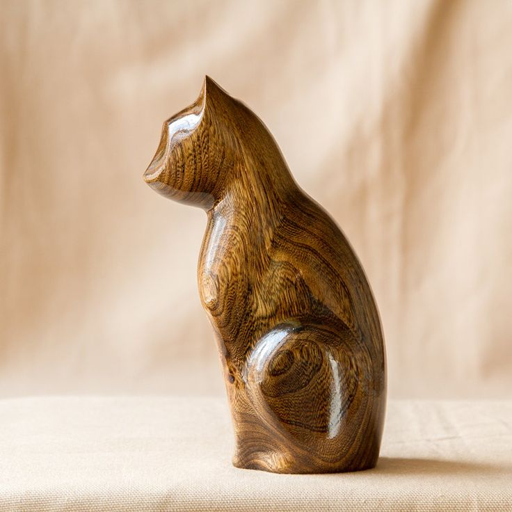 Wooden Cat carved ash-tree.  The wood material for all my work I am loking for in the wood by myself. Every figurine has been carved entirely by hand, by myself, in my small workshop. The statue painted in varnish to add shine and that shows the natural texture of the wood. A good present for birthday or anniversary. Beutiful for home decoration.  Measures: Width: 1.9in \ 5сm; Height: 5.5in \ 14.5cm;  Contact me if you have any question or you want custom order. Ill help you with pleasure…