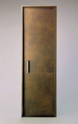 Bronze clad interior door and jam with custom handle