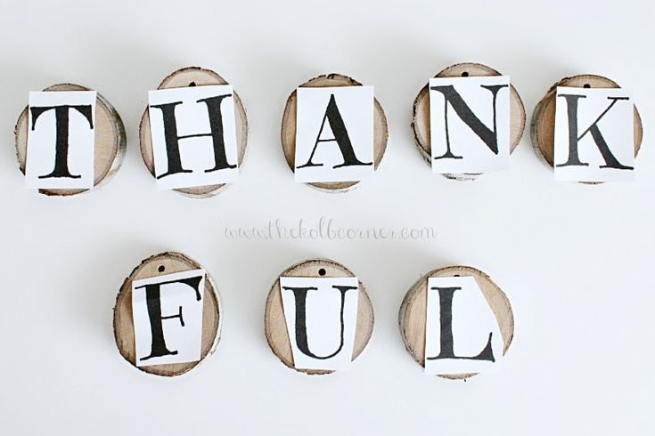 """Got some wood lying around or some slices? You can easily make this """"thankful"""" rustic wood slice garland for Fall in just a few steps! #rusticwoodslicegarland #thankfulgarland #thankfulbanner #woodbanner #woodgarland #domesticallycreative"""