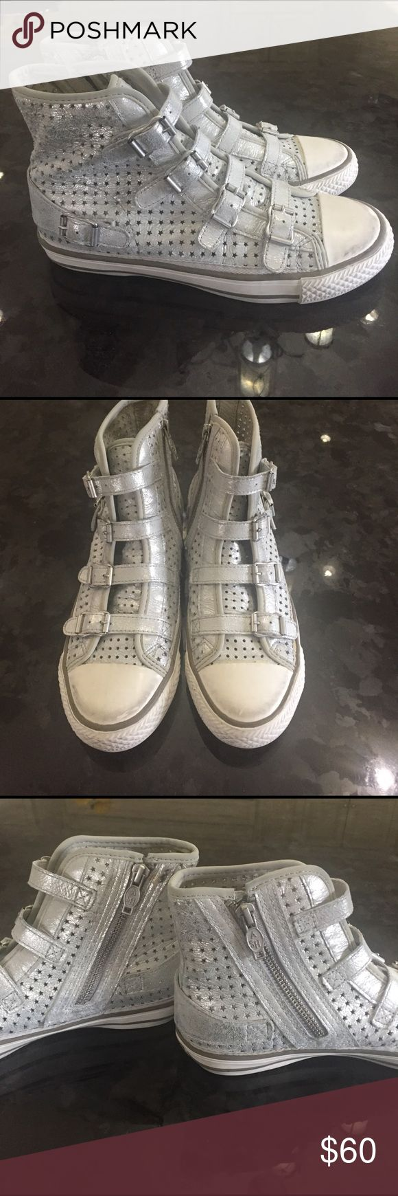 Soft silver leather sneaker Ash sneakers .. worn but not abused at all!!Vintage leather distressed sneaker. Zippers up the side for easy access.  The ash sneaker is distressed even brand new. That is the look of this sneaker. Runs big because I'm usually 6 1/2 but when I buy Ash, I'm a 6. ASH Shoes Sneakers