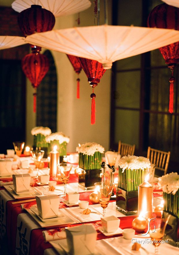 table decor: red, white and gold - the pop of green kinda incorporates a pnw feel. not a fan of the takeout box though!