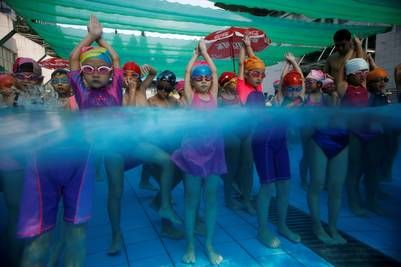 Entrenamiento de nadadores chinos en los Juegos Olímpicos Río 2016. REUTERS/Aly…
