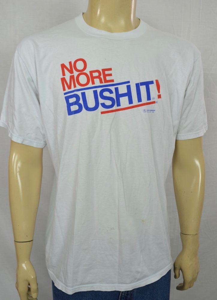 """Vtg NO MORE BUSHIT! White T-Shirt RARE Political Comedy Sz XL Cotton. white t-shirt with a crewneck. - Sz XL -. Material - 100% Combed Cotton. Length (top of Collar to Base) = 30.5 """". Arm pit to arm pit = 23.5"""". 