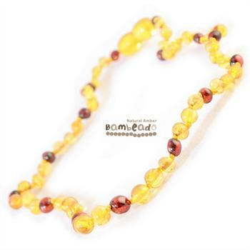 Wearing this amber necklace might help your baby with teething or eczema.This premium amber necklace comes in a combination with a darker bead as a distinctive look. Amber beads are finished in a polish compared to the standard bud range. The amber necklace is approx 37cm in length. Bambeado amber is genuine baltic amber. Bambeado's are to be worn and not chewed. Each bead is individually knotted to help with safety.       The Bambeado comes together with a plastic screw clasp.