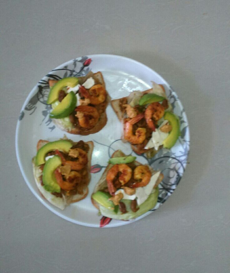 Prawn sandwich with lettuce, pinto beans cooked with mustard sauce,Paneer,lemon fried prawns and avocado, garnished with mustard sauce.