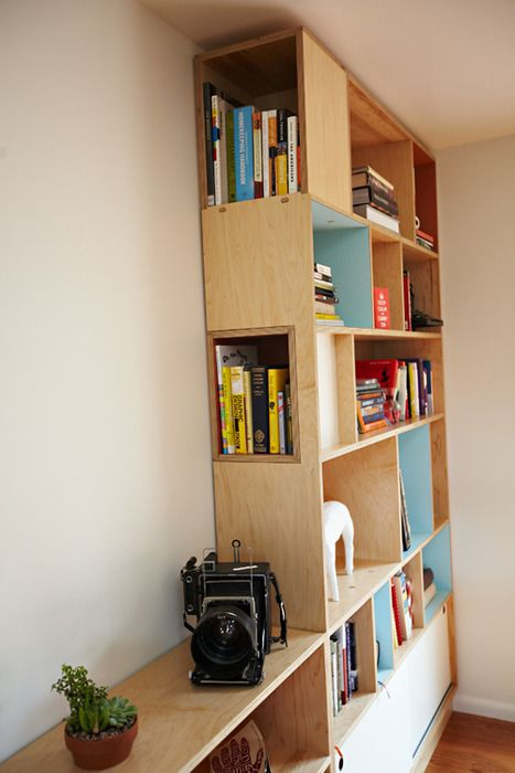 Kerf Design Bookcase. Cool side facing shelves. Use at desk area near living room.
