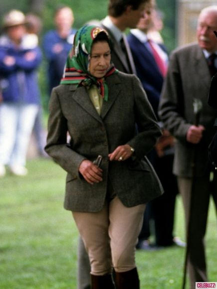 """One of Her Majesty's greatest loves is horses. If she's not at Buckingham Palace (which she considers """"her office""""), the Queen is out at Windsor Castle, preferring to be near the stables where her horses are kept. Here, the Queen wears a riding scarf atop her head and jodhpurs at the Royal Windsor Horse Show in May 1988.' I hope I look that good at 62.. Me too."""