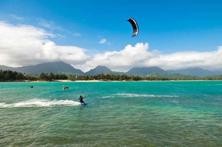 Woman kitesurfing off Flat Island, Kailua Bay, Oahu, Hawaii. #kitesurfing #kiteboarding