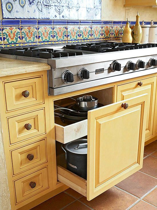Keep your pots, pans, and lids underneath your range for quick access: http://www.bhg.com/kitchen/storage/organization/storage-packed-cabinets-drawers/?socsrc=bhgpin02062014closetothecooktop&page=12