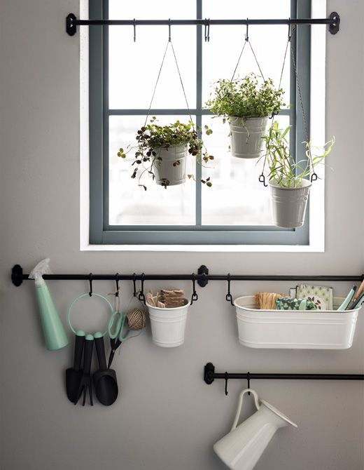 Bitten by the gardening bug? Set up a plant station with a mix of rails across and around a window. Here we used cutlery stands as pots. Play with different lengths and attach them using string. Store your tools in condiment stands fastened with hooks.
