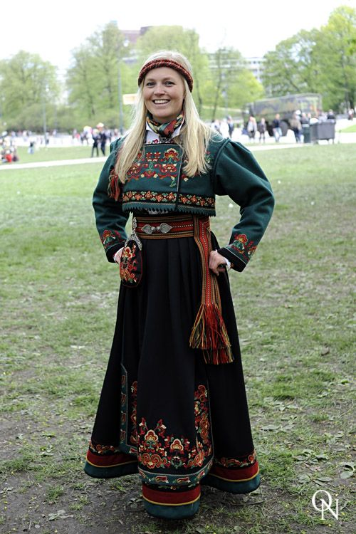 National Costume (bunad) from East Telemark County with a green jacket, rather than the usual red.