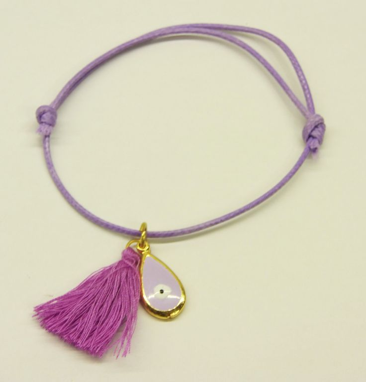 Handmade bracelet/purple cord/purple tassel/base metal rain drop charm/gold plated/24 carats/purple enamel/eye enamel by CrownedCharm on Etsy