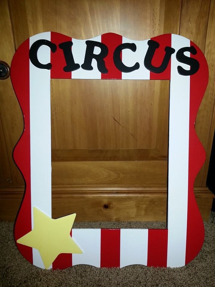 A photo op picture frame for a circus theme birthday party.  Use props like mustaches, hats, glasses, etc. to create a fun memory.  Frame form Michaels and then I bought red and white duck tape.  Letters are craft letters that I hot glued on!  Easy and fun project.