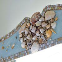 Custom handmade cornice with seaglass tiles and seashells. By designer Ann Fox.