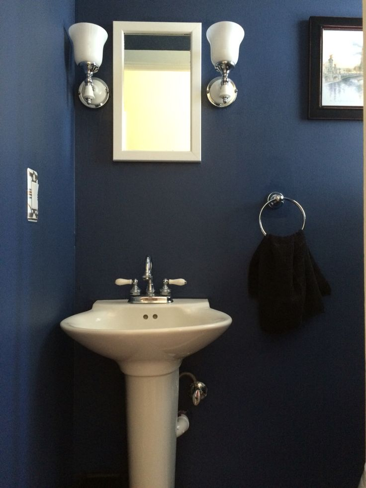 Wall paint is Indigo batik from Sherwin Williams Small powder room or 12 bathroom with a color