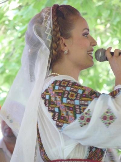 Romanian woman wearing a Marama headscarf