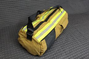 You are purchasing the bag seen above. This bag looks brand new. Its made from a used pair of bunker pants that were around 12 yrs old. The