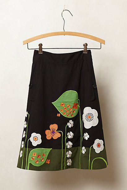 Super cute Anthropologie skirt $128, I could make this for way cheaper. Black a line skirt, add appliques.